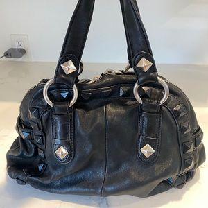 Linea Pelle black leather stud handbag